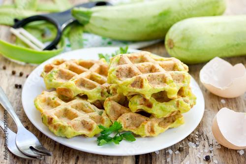 Zucchini waffle, zucchini fritters cooking on waffle maker, vegetarian zucchini pancakes