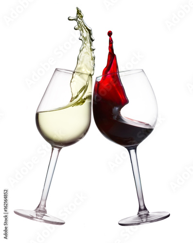 Two wine glasses with splashing of red and white wine isolated on white background, wine tasting concept