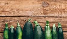 Fresh Farmer Organic Zucchini On A Wooden Background