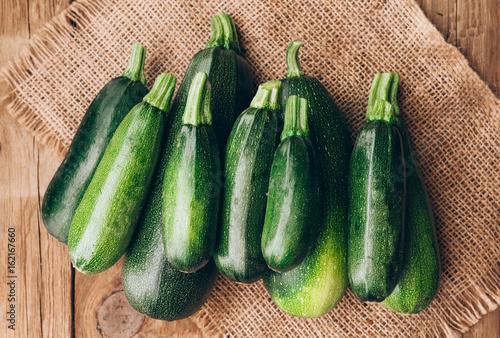 Fresh farmer organic zucchini on a wooden background Canvas Print