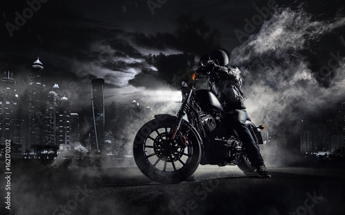Fototapeta High power motorcycle chopper with man rider at night