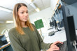 pretty female student looking at a desktop computer screen