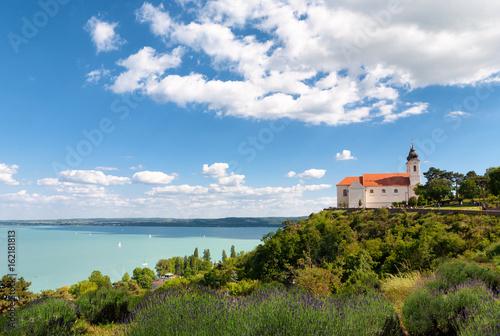 Photo  The beautiful Tihany Benedictian Abbey with the Lake Balaton, Hungary