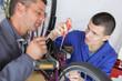 bicycle mechanic working on mountain bike