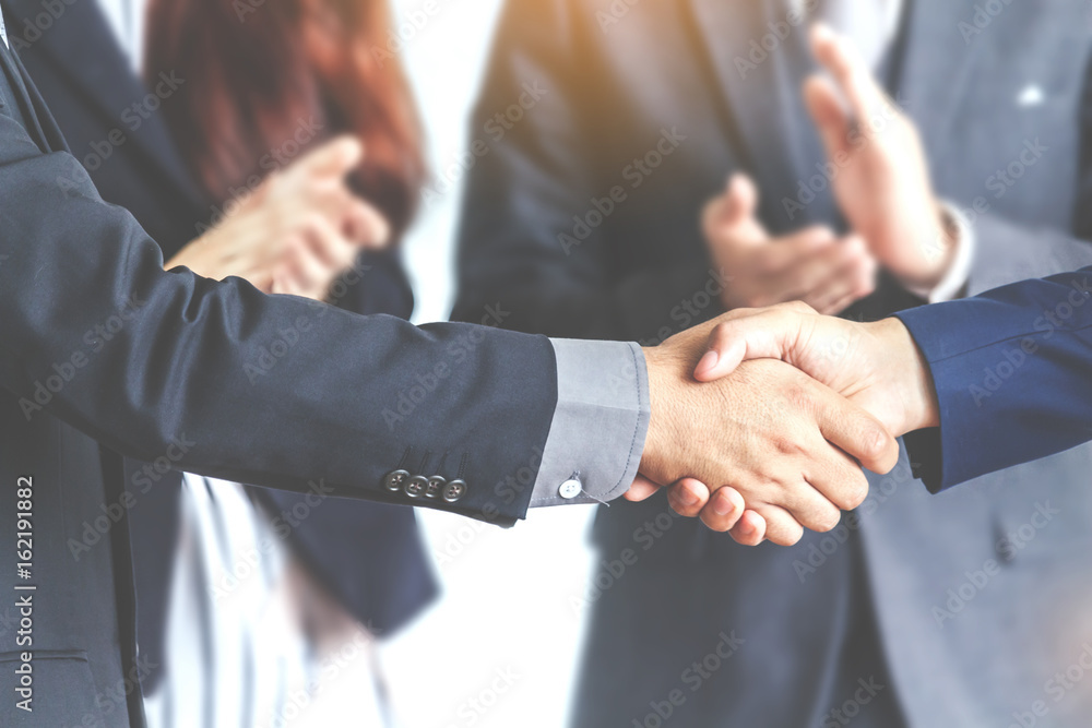 Fototapeta Handshake of business partners