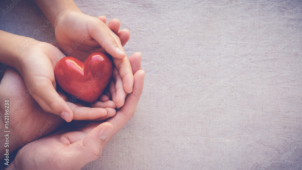 Fototapeta adult and child hands holding red heart, health care, love and family insurance concept, world heart day, world health day, adoption foster family, international day of families