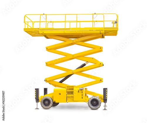 Fototapeta Scissor wheeled lift on a light background obraz