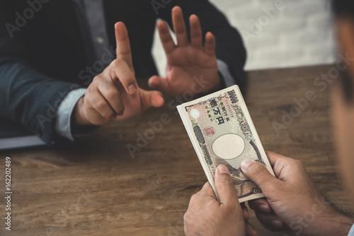 Businessman rejecting money, Japanese yen banknotes - anti bribery and corruptio Canvas Print