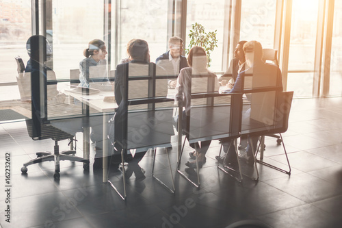 Obraz Corporate business team and manager in a meeting - fototapety do salonu