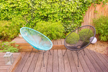 Two Garden Chairs In A Small M...