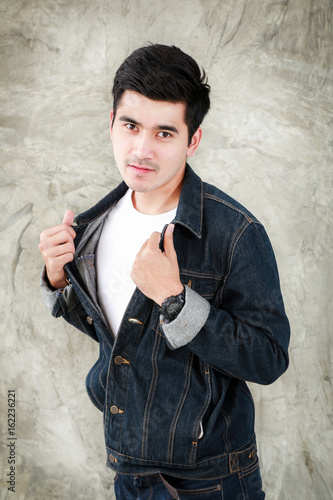 Closeup Asian Man Casual Outfits Standing In Jeans And Black Denim