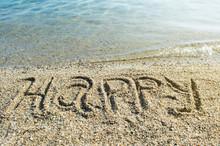 Word Happy Written On The Beach