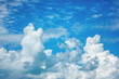 Blue sky with fluffy clouds, background and texture