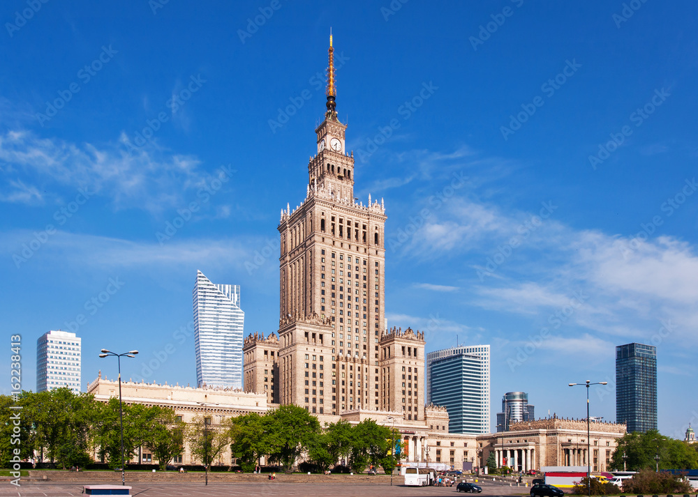 Fototapety, obrazy: Warsaw city center with Palace of Culture and Science (PKiN), a landmark and symbol of Stalinism and communism, and modern sky scrapers.
