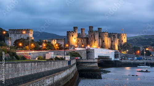 Poster Northern Europe Conwy, Wales, United Kingdom - September 16, 2016: World heritage Conway castle in Wales in evening.