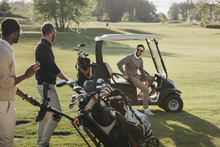 Multiethnic Friends With Golf ...