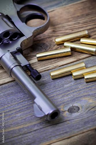 Fotografie, Obraz  part of an vintage nagant revolver with cartridges