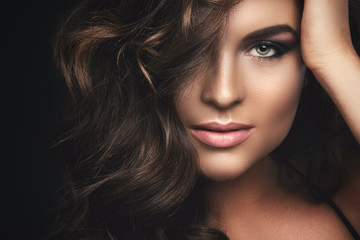 Woman with curly hair and beautiful make-up