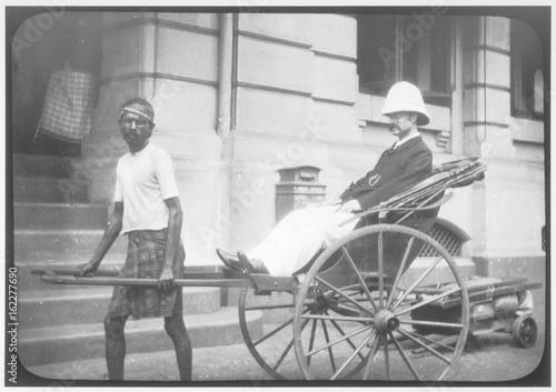 Man in Rickshaw. Date: 1890s Fototapet