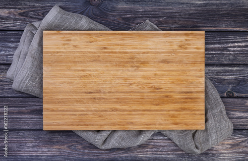 Serving tray over old wooden table, cutting board on dark wood background, top view