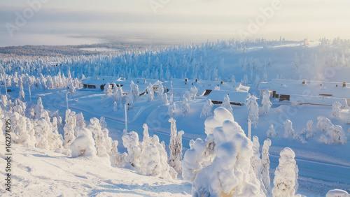 Photographie  Beautiful cold mountain view of ski resort, sunny winter day with slope, piste a