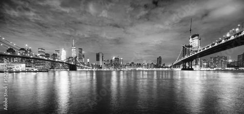 Brooklyn Bridge and Manhattan Bridge at night, New York City, USA.
