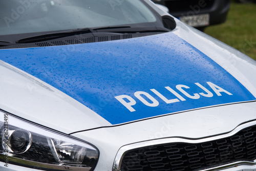 Obraz na płótnie close up on Policja (Police) sign on car