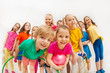 Leinwanddruck Bild - Sporty kids and gymnastics coach having fun in gym