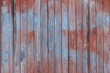 Background of old wooden board with cracked red paint