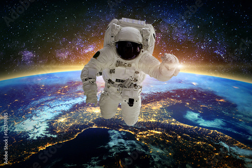Tuinposter Nasa Astronaut in galaxy. Elements of this image furnished by NASA.