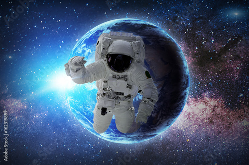 Deurstickers Nasa Astronaut in galaxy. Elements of this image furnished by NASA.