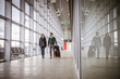Young couple with lugggage in airport building