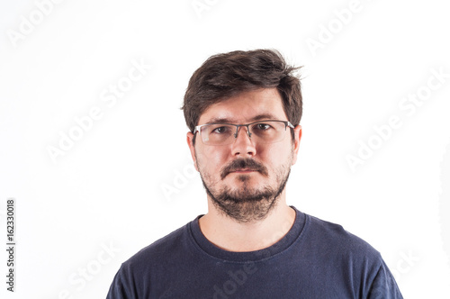 Fotografie, Obraz  Caucasion man with glasses, beard and Disheveled hair look into camera
