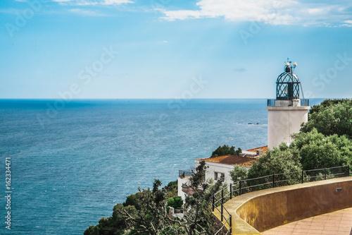 Fotografiet View on the lighthouse Far de Sant Sebastia, Costa Brava, Spain