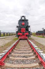 Old Black Steam Locomotive On Cloudy Sky Background. Nizhniy Novgorod, Russia.