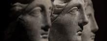 Three Headed Roman-asian Ancient Statue Of Beautiful Women At Black Background