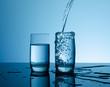 Creative splashing water in the glass