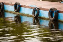 Row Of Black Car Tires Used As...