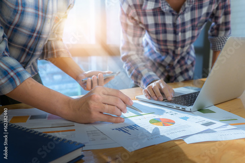Fototapety, obrazy: Close up of business man hand pointing at business document on financial paper during discussion at meeting. Group support concept.