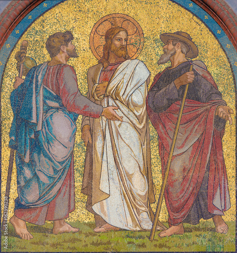 BERLIN, GERMANY, FEBRUARY - 14, 2017: The mosaic of Jesus with the disciples on the road to Emmaus on the facade of church Emmauskirche by workroom Deutschen Glasmosaik - Gesellschaft Puhl & Wagner Fototapeta