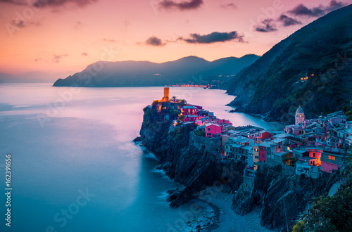 Photo sur Aluminium Ligurie view of famous travel landmark destination Vernazza,small mediterranean old sea town with harbour coast and castle,Cinque terre National Park,Liguria, Italy. Summer colorful sunset with street lights