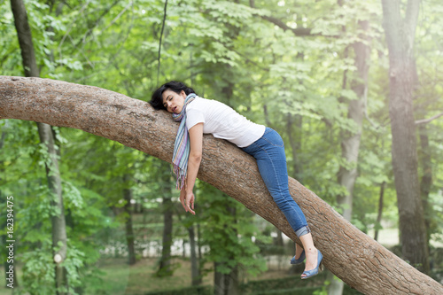 Cuadros en Lienzo pretty woman sleeping in a tree after being over worked and having trouble sleep