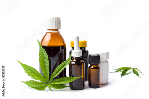 Photo  Marijuana and cannabis oil bottles isolated