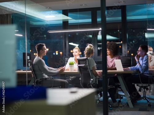 Fotografie, Obraz  Multiethnic startup business team in night office