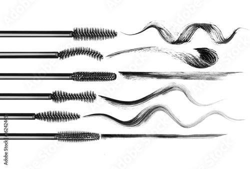 Valokuva  Set of various mascara brushes with mascara strokes on white background