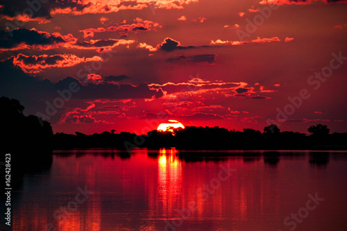 Spoed Foto op Canvas Bordeaux Sunset on the Chobe River, Botswana