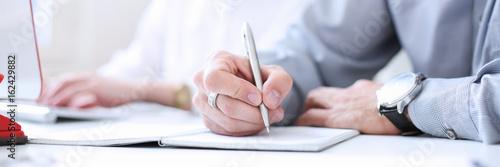 Fotografia  Businessman holding pen in hand