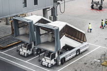 Airport Service Vehicles Standby On Airport Tarmac