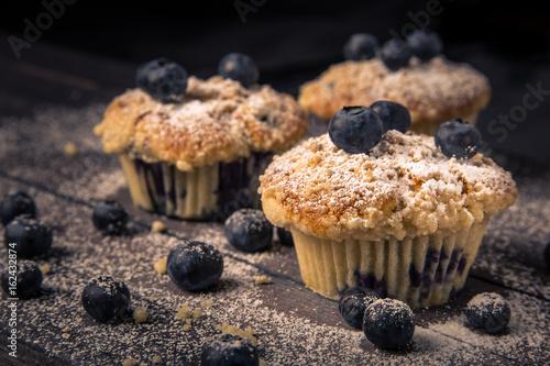 Fotografie, Obraz  blueberry muffin, wood background, horizontal