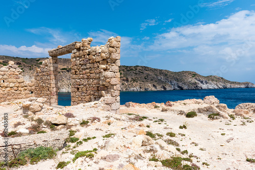 Foto op Aluminium Rudnes The ruins of an ancient building in the picturesque village of Firopotamos on Milos Island. Cyclades, Greece.